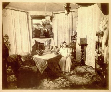 59 Megowan St., Belle Brezing's third and most famous bordello, 1889-1917; Brezing occupied the house until her death in 1940, interior; Brezing in her private parlor, 1890. The Belle Brezing Photographic Collection,