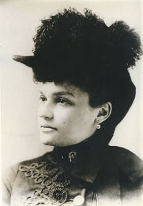 Belle_Brezing_in_a_feather_hat_(circa_1895)