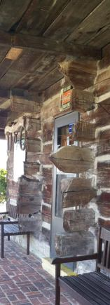 Entrance to corn crib/mule barn. Look at all those projecting log ends!