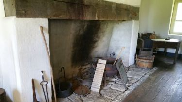Stone kitchen. In the large room to the left. Built several years after 1790.