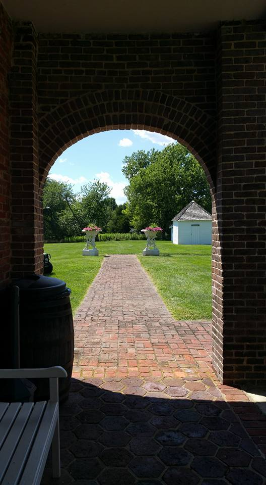 View from the rear walkway of the house, towards the smoke house.